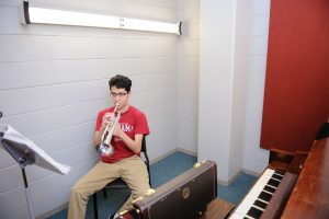 student practicing a trumpet